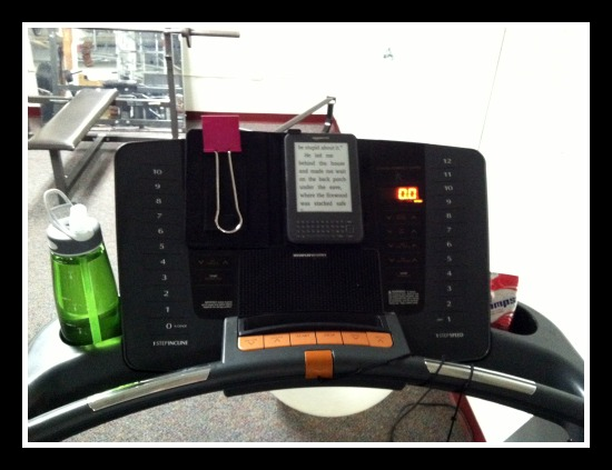 Yes, that is a giant paper clip to keep the Kindle from shakin from my thunderous strides.